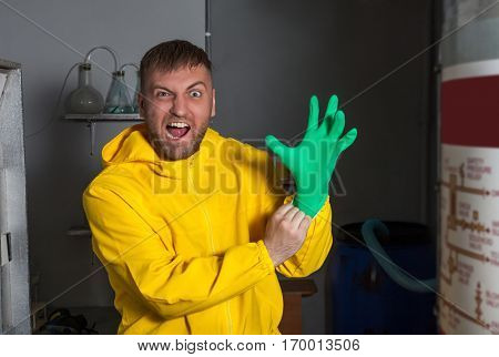 Mad man in protective outerwear suit wearing rubber gloves
