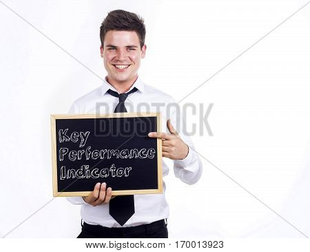 Key Performance Indicator Kpi - Young Smiling Businessman Holding Chalkboard With Text