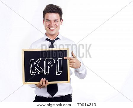Kpi - Young Smiling Businessman Holding Chalkboard With Text