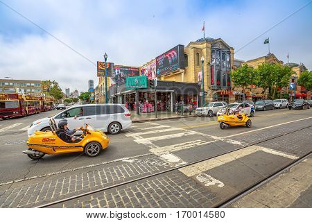 San Francisco, California, United States - August 14, 2016: GoCar Sightseeing Tour on Jefferson rd Mason st corner at Fisherman's Wharf district. Freedom and travel concept. San Francisco street view.