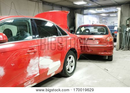 Crashed cars in a car repair station