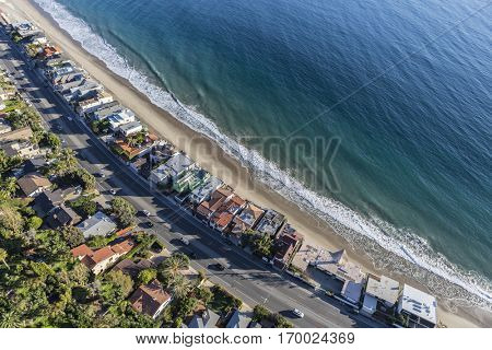 Aerial of beach homes along Pacific Coast Highway in Malibu California.