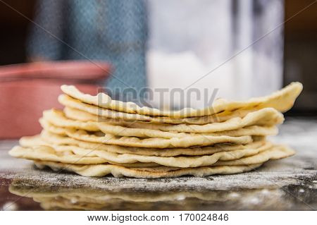 Stack of Flour Tortillas with Flour Bin and container in Background