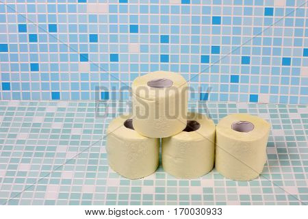 Rolls of toilet paper on the tile