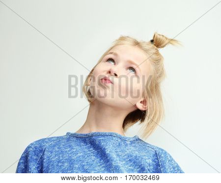Funny teenager girl with freckles on white background