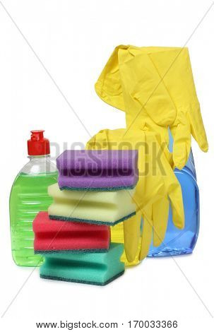 Protective rubber gloves and cleaning products on white background