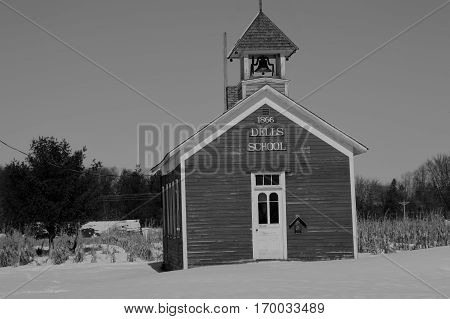 DELLS POND WISCONSIN  Old Historic one room school house. Dells Pond is a historic settlement in Wisconsin. (black/White)