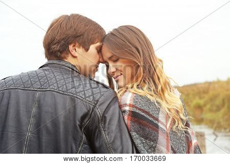 Beautiful young couple having date outdoors, close up
