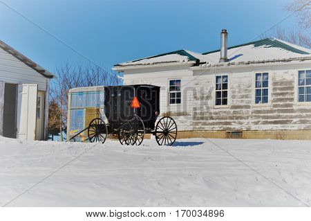 Amish buggy in the winter Central Wisconsin USA