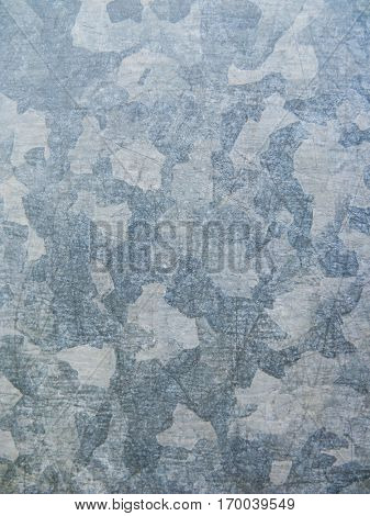 Galvanized plated metal surface background. Urban camouflage effect.