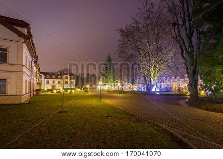 GDANSK, POLAND - DECEMBER 17, 2016: Beautiful Christmas illumination at the Park Oliwski of Gdansk, Poland. Park Oliwski is the biggest heritage park in Gdansk with area of 11,3 ha (113 000 m2).