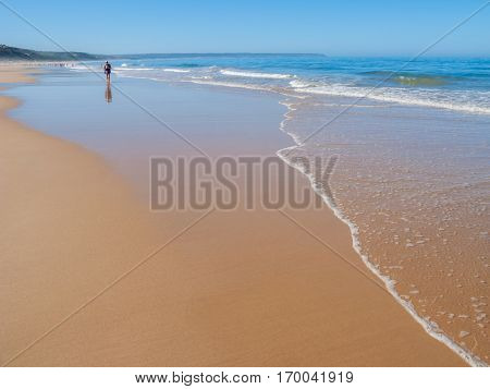 Fonte da Telha Beach in the Costa da Caparica coast during summer. The preferred coast for Lisboans to beach. Portugal