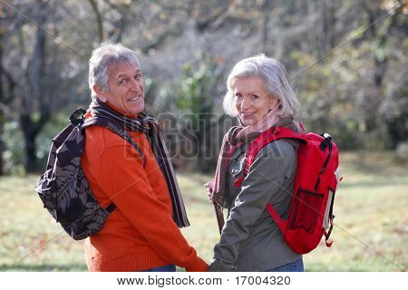 Closeup of senior couple hiking in countryside
