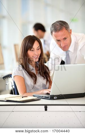 Manager and office worker in wheelchair