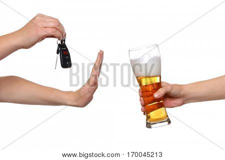 Woman with car key refusing glass of beer, on white background. Don't drink and drive concept