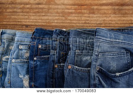 Set of blue jeans on wooden.board