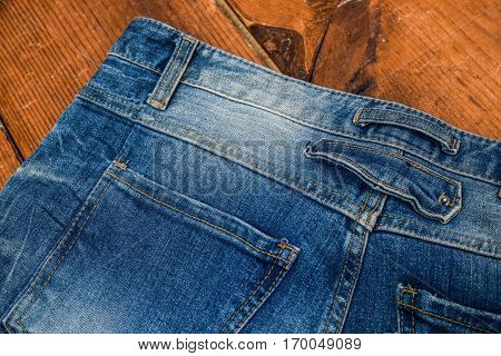 Details from back blue jeans