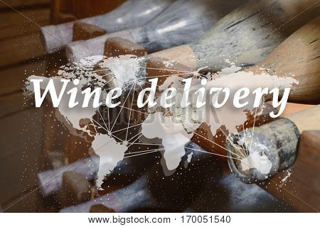 Text WINE DELIVERY and world map on wine bottles background