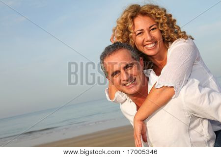 Portrait of happy mature couple at the beach