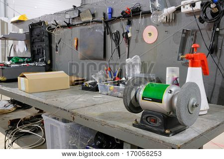 The image of grinder in the service station