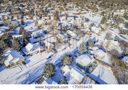 aerial  view of typical residential neighborhood along Front Range of Rocky Mountains in Colorado, winter scenery