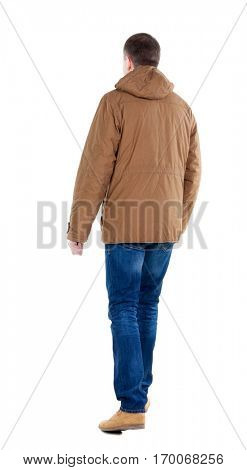 Back view of going  handsome man in brown parka. walking young guy . Rear view people collection.  backside view of person.  Isolated over white background.