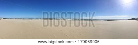 Panoramic view of Sandbanks beach UK on  a blue sky sunny day.