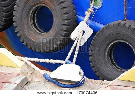Bollard rope and tyre fender on tugboat