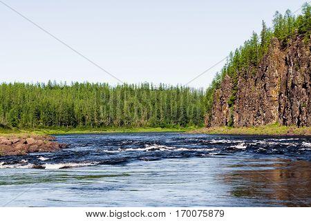 The rocky shore of a large river. Big river of Eastern Siberia. Krasnoyarsk region.