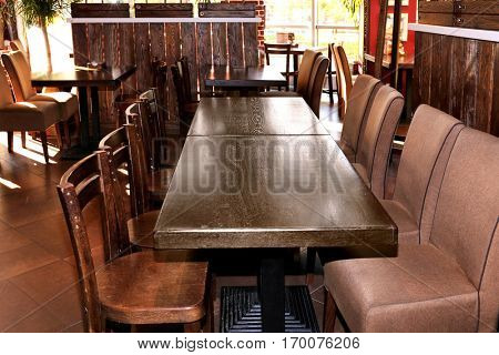 Lacquered table and chairs in modern cafe