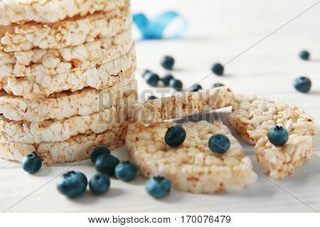 Round rice crispbreads with blueberries, closeup