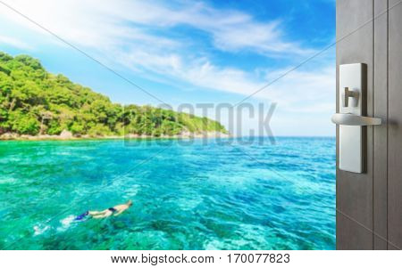 Opened Wooden Door To Tourist Snorkeling In Tropical Clear Sea Near The Green Island At Sunny Day