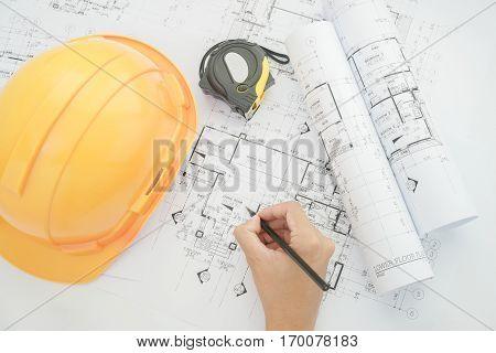 Architect Working On Construction Blueprint. Architects Workplace - Architectural Project, Blueprint
