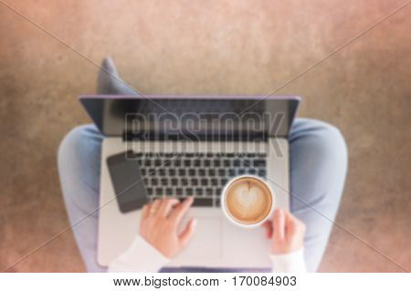 Woman sitting on floor with laptop stock photo