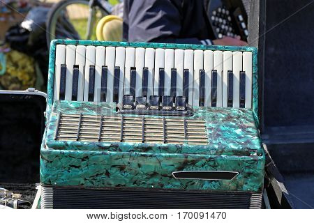 Used Green Piano Accordion Musical Instrument at Flea Market