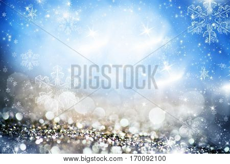 blurred bokeh of Christmas lights. Magic holiday abstract glitter background with blinking stars and falling snowflakes.
