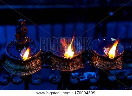 Oil Lamps burning at the religious place Swayambhunath in Nepal.