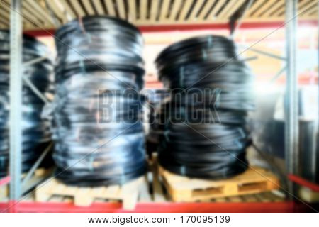 Warehouse industrial and logistics companies.Coiled plastic pipe. Deep blur effect.