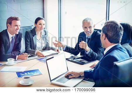 Businesspeople discussing together in conference room during meeting at office