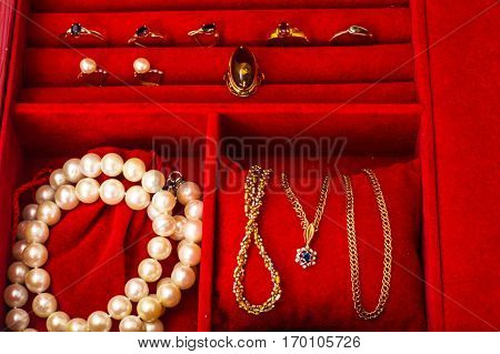Natural pearl white beads on red Case. Studio Photo