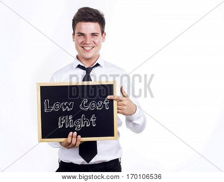 Low Cost Flight - Young Smiling Businessman Holding Chalkboard With Text