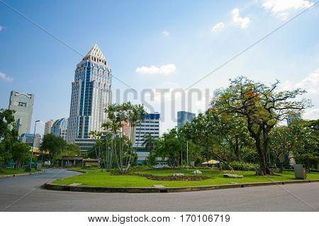 The modern building among natural park landscape of Bangkok city