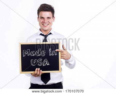 Made In Usa - Young Smiling Businessman Holding Chalkboard With Text