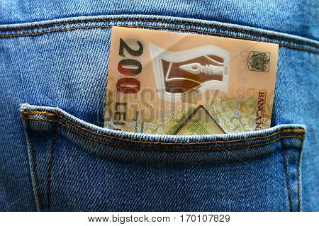 Back pocket with money blue jeans close detail