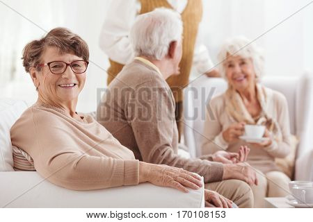 Older happy woman on a meeting with old friends