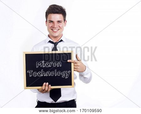 Micron Technology - Young Smiling Businessman Holding Chalkboard With Text