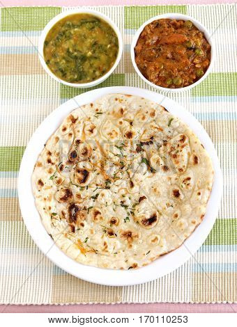 Indian food kulcha, a type of traditional and popular bread, and vegetable curries.