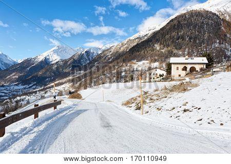 Country road  in the beautiful sunny morning, Guarda, Lower Engadine, Graubunden, Switzerland.