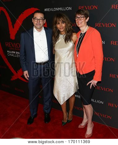 NEW YORK-DEC 01:(L-R) Revlon CEO Fabian Garcia, Halle Berry & Dr. Jill O'Donnell-Tormey attend Revlon's Love Is On Million Dollar Challenge Party at The Glasshouses December 1, 2016 in New York City.
