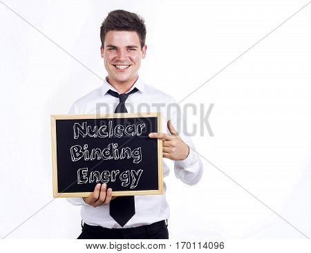 Nuclear Binding Energy - Young Smiling Businessman Holding Chalkboard With Text